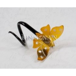 Butterfly napkin made of yellow marble buffalo horn